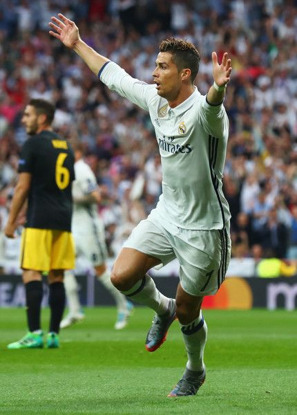 Cristiano Ronaldo of Real Madrid (7) celebrates as he scores their first goal during the UEFA Champions League semi final first leg match between Real Madrid CF and Club Atletico de Madrid at Estadio Santiago Bernabeu on May 2, 2017 in Madrid, Spain.