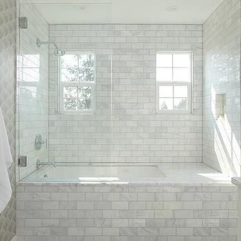 Drop in Bathtub with Carrara Marble Subway Tiles a…