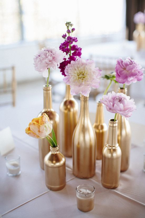 Spray paint bottles and jars gold. Over white tablecloths?