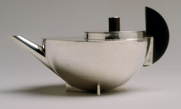 Brandt's tea infuser is the quintessential Bauhaus object. Only three inches high, its diminuitive size results from its function. Unlike conventional teapots, it is intended to distill a concentrated extract, which, when combined with hot water in the cup, can produce tea of any desired strength. (Marianne Brandt, ca. 1924)