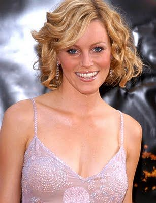Medium Curly Hairstyle with Side Bangs Hair for Women from Elizabeth Banks