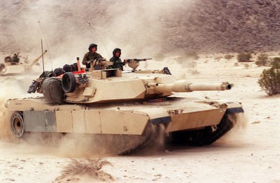 "US M-1 Tank. ""Everything from the history of the 1st Cavalry Division to the evolution of the M1 Abrams in the Iraq Conflict and a fascinating digression on Rommel's desert tactics added up to a massive zero for her."" Threading the Needle by Gabriel Valjan."