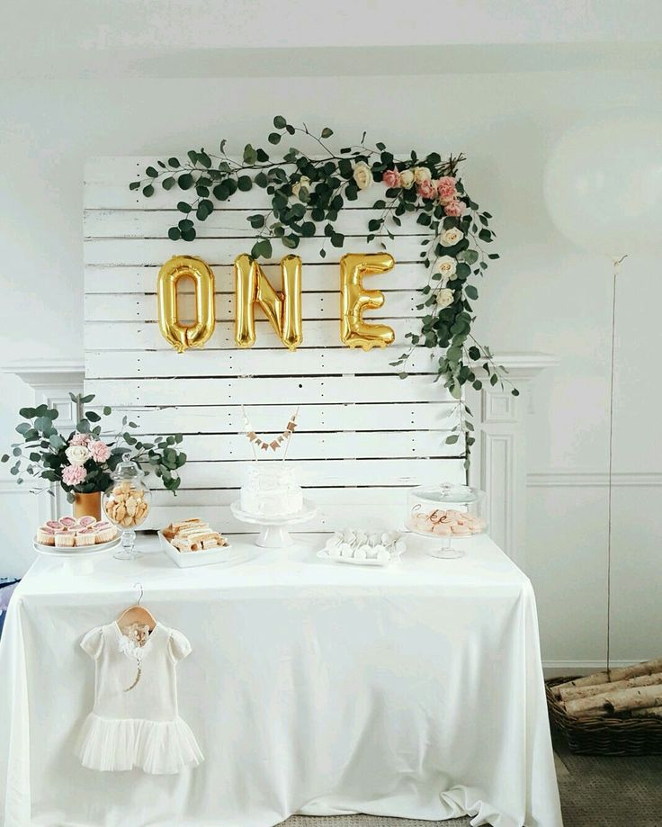 eucalyptus decor for a pink and gold baby girl 1st birthday party