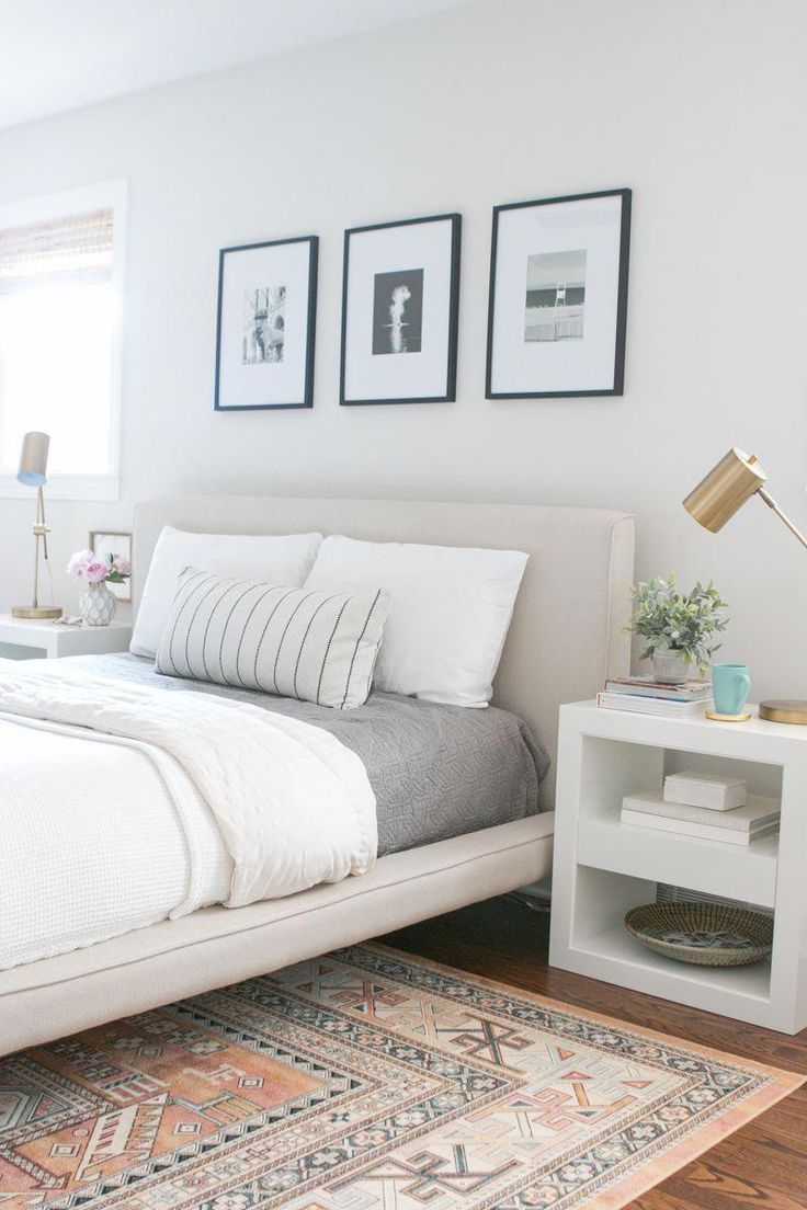 this neutral bedroom with a tribal rug and white
