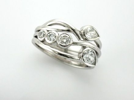 'ANYA' - Signature Brook Wave Ring set with Pear Shape & Brilliant Cut Diamonds  in this Unique Engagement Ring   Custom Made in 18ct White Gold.      The Matching Wedding Band sweeps behind Anya to Complete the Look!
