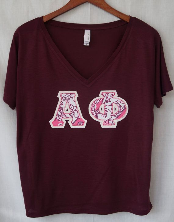 Charcoal Bella Flowy v-neck with drop sleeves featuring the Alpha Phi Lilly Pulitzer print on a white backing.