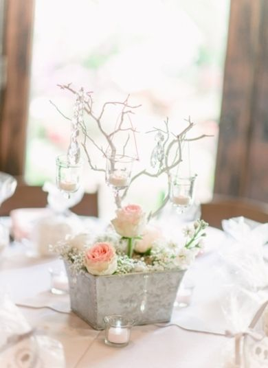 #Candles and #flowers make a great center piece | Photo by: Pasha Belman on Southern Weddings via Lover.ly