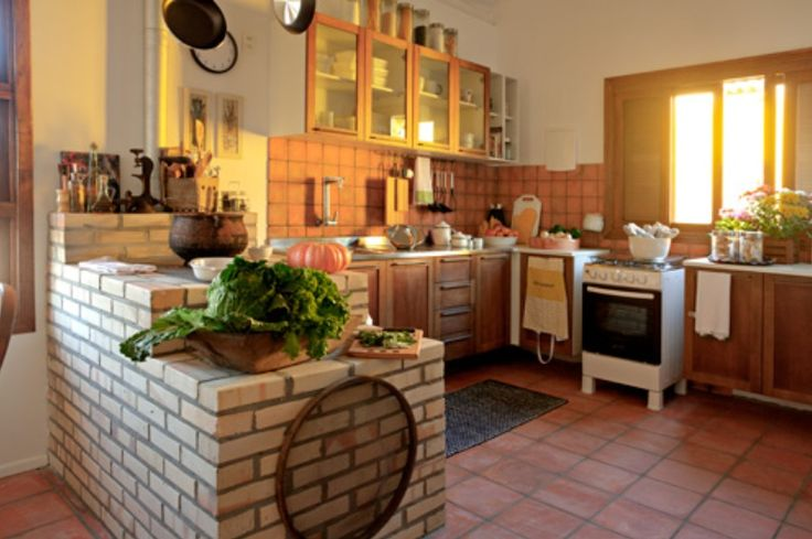 Hybrid kitchen, traditional fogao a lenha AND a gas range/convection oven.