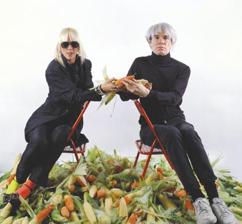 """Marta Minujin (Argentina, b. 1943), with Andy Warhol (U.S., 1928-1987) Paying off the Argentine Foreign Debt with Corn, """"the Latin American Gold"""", 1985. Minujín invited Warhol to this New York performance in which she enacted paying off Argentina's external debt using corn, the traditional Latin American food staple and most widely grown crop in the Americas."""