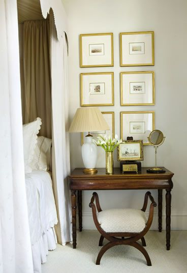 Mrs Howard (Atlanta showhouse) bedside table with stacked gold framed pictures