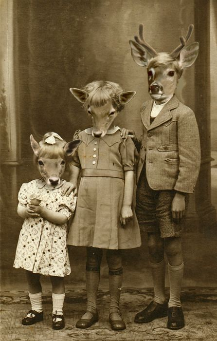 family photos -- why do many old photos have people wearing animal heads? OMG  sooo WEIRD