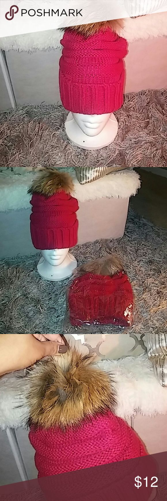 **New w/o tags ladies winter hat **New w/o tags ladies winter hat. Magenta with brown pom pom. Very thick and warm to cover ears. unknown Accessories Hats