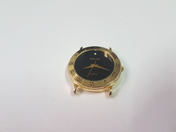 Vintage Infinity Gold-Black Tone Watch - Special Ladies Watch - Awesome looking Watch  Quartz Movement Will also add telescopes when shipping, so that you can add your watch band.      Swatch Collection : https://www.etsy.com/shop/InstaAntiques?ref=l2-shopheader-name&section_id=20319988    All watches exposed are part of a big collection. I will keep on adding until I reach 1000 watches on Etsy! My father and grandfather have collected watches for almost 80 y...