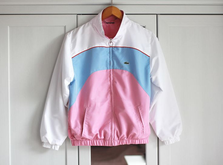 Vintage Windbreaker  *LACOSTE brand jacket *1990s look *Baby Pink/White/Blue color *Loose fit *Classic oldschool look *Polyester & Cotton *Great condition (one pale stain - so pale that not even visible in the last picture)    Size: Medium/Large  Bust: 42 1/2 inch / 108 cm Length: 22 inch / 56 cm Outer Sleeve: 22 3/4 inch / 58 cm Inner Sleeve: 18 inch / 46 cm      You can also check other jackets from my shop: https://www.etsy.com&#x2...