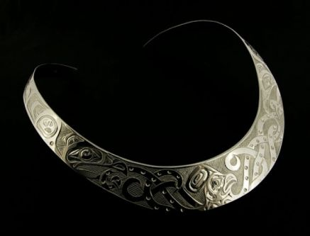 This is a striking, bold collar necklace carved in the Haisla style. Hand-engraved by Haisla artist Kelvin Thompson, with an Octopus and Ravens design, this is a show-stopper! In Northwest Coast First Nations culture, the Raven is a symbol of creation and the Octopus is a symbol of transformation. $1300. By Kelvin Thompson.