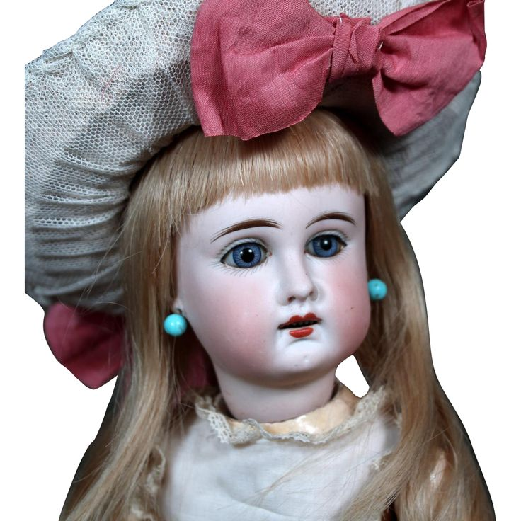 Offered is a very pretty 15.5 Sonneberg child doll made as a french look alike with blue paperweight eyes, pierced ears, and an open mouth with six