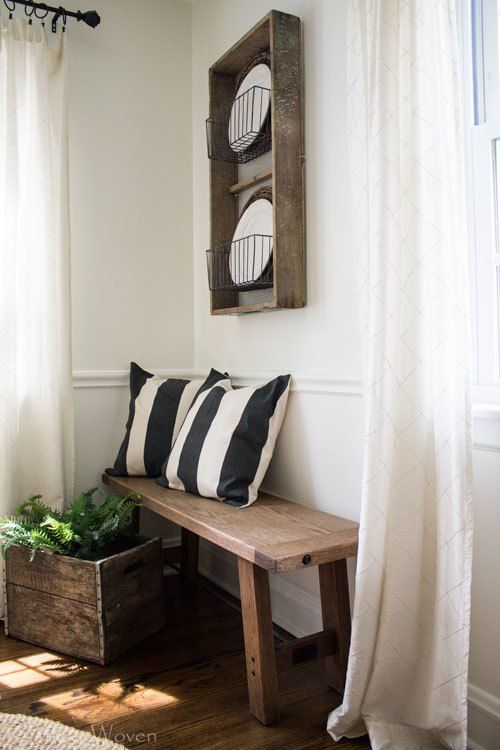Rustic Plate Rack And Wood Bench Neutral Farmhouse Dining Room With Black White Accents