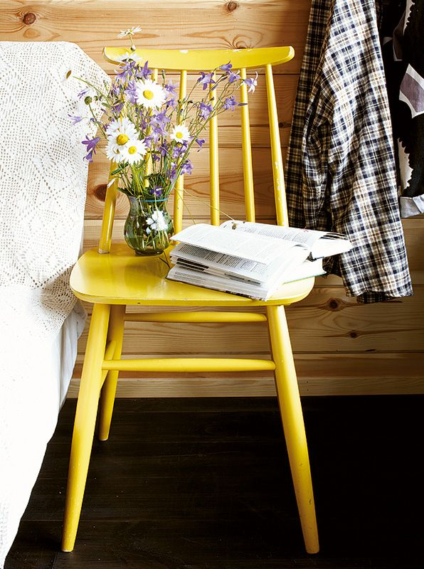"Lovely yellow chair as bedside table. I'd add basket below for ""stuff""."