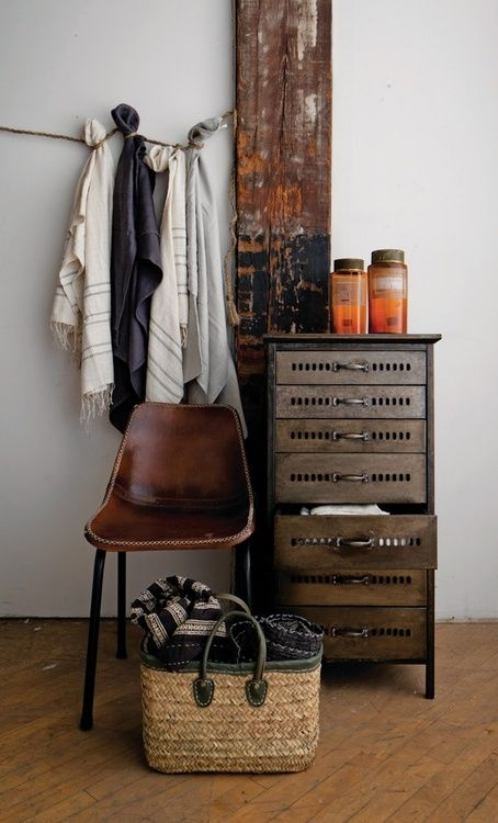 Simple modern rustic - Super weathered plank as wall decor.