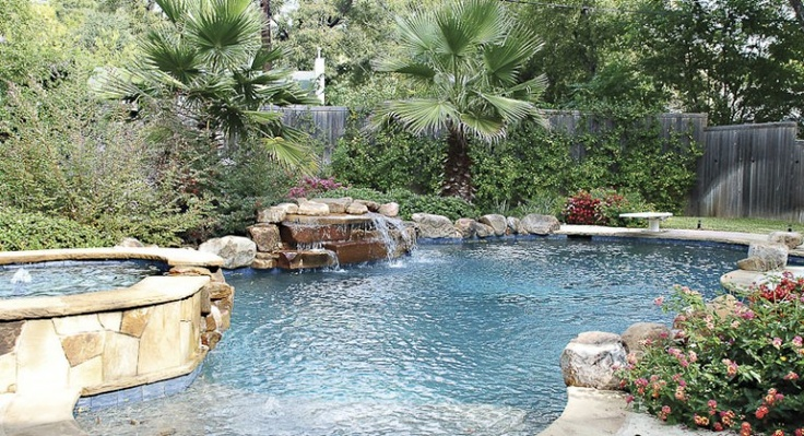 Nice little paradise pool and spa hot tub love the stone for Landscaping rocks dallas