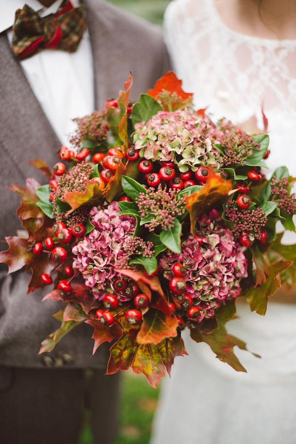 unique winter bouquet with berries, photo by Trentième Étage http://ruffledblog.com/french-woods-wedding-inspiration #flowers #bouquet #wedding