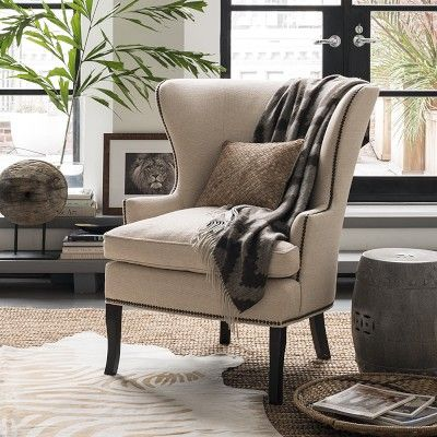 http://www.williams-sonoma.com/products/chelsea-wing-chair-upholstery/?pkey=e%7Cchelsea%2Bchair%7C1%7Cbest%7C0%7C1%7C24%7C%7C1&cm_src=PRODUCTSEARCH||NoFacet-_-NoFacet-_-NoMerchRules William-Sonoma Chelsea Wing Chair, Fabric Grade C; Nailhead: Antique Brass; Fabric/Color: Chenille Basketweave, Blue Smoke