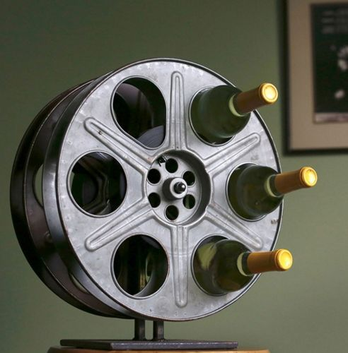 Store your wine in a repurposed film reel. | 24 Glam Decor Ideas For People Who Love Classic Hollywood