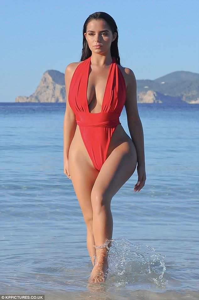 4d4a503a4a Demi Rose flaunts her ample assets and pert derriere in thong swimsuit