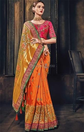 1ae6859ae75ce3 Get This Graced Orange Banarasi  Silk  Saree With Scoop Necked Blouse  Design  Online. This  Designer  Printed  Saree  Blouse Has Half Sleeves