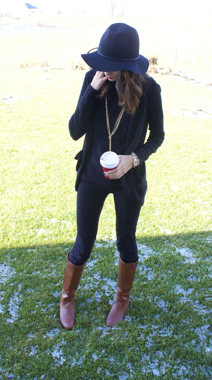 Black floppy hat, gold tassel necklace, all black outfit with cognac riding boots winter 2014