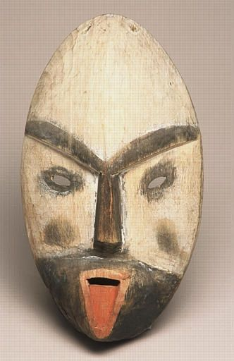 """Masque, Archipel de Kodiak, Alaska, collecté en 1871/2 par Alphonse Pinart (1852-1911) Il tire la langue aux mauvaises  langues  ou à  ceux qui ont la langue  bien pendue  au moment  même  où il faudrait  avoir langue  de bois.... """"Bois-ye - vous """" bien  de quoi qu'est ce ce donc je veux parler  vous les mal pensants !!!"""