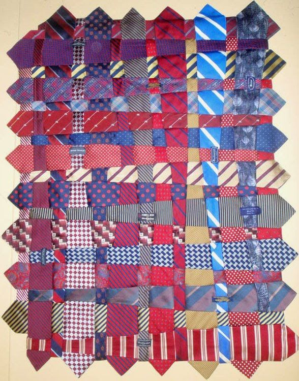 Tie quilt. I've a bag of non-fashionable (they were at the time) ties. I was planning on doing the skirt thing, maybe a dress thing if I located enough but this looks a far better use for them. Make up about 4 of these panels and stitch them together, add a backing fabric and you've a lovely decent sized throw/blanket.