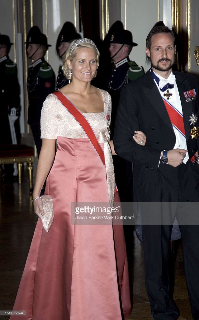 24 February 2007: 70th Birthday of King Harald V  Full white-tie attire for a ball at the Royal Palace -- Mette-Marit wore her wedding tiara, Crown Princess Märtha's silver wedding earrings, a diamond bracelet, the Order of St. Olav, and her father-in-law's family order.