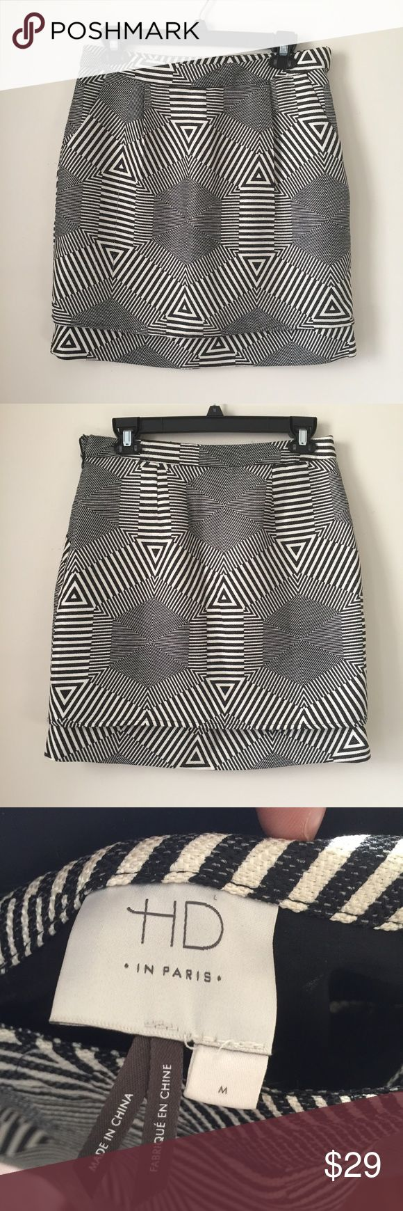 HD in Paris Black & White Geomaze Skirt Medium HD in Paris black and white geomaze skirt featuring double-layer bottom hem, front pockets(!), and side zip. Polyester with poly/spandex lining. Size medium.  There is a snag in the fabric as shown in the photos but the print is so busy that it makes it less noticeable. Otherwise great condition. Anthropologie Skirts Mini