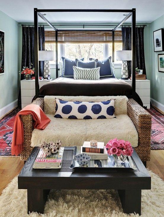 bed in front of window; sitting space in bedroom; coffee table arrangement