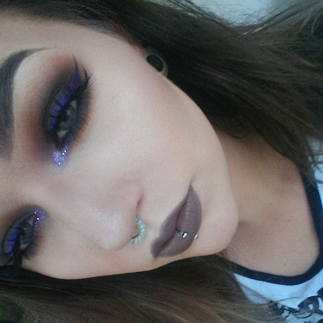 A crappy picture of my makeup today. Face: @maccosmetics Pro Longwear foundation & concealer, @katvondbeauty shade & light palette, @beccacosmetics Moonstone, @anastasiabeverlyhills dipbrow Ebony. Eyes: @katvondbeauty Monarch palette, @makeupgeekcosmetics Peach Smoothie, Cocoa Bear and Pop Culture, @glitterinjections Pretty Lilac Liar and @jeffreestarcosmetics I'm Royalty as liner. Lips: @maccosmetics matte lipstick Stone. Septum clicker from @lotusandco