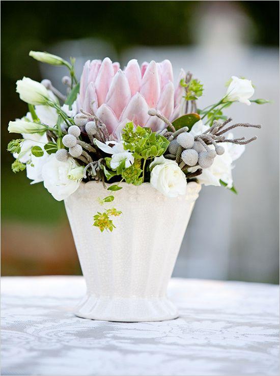 Protea in white vase (via Wedding Chicks)