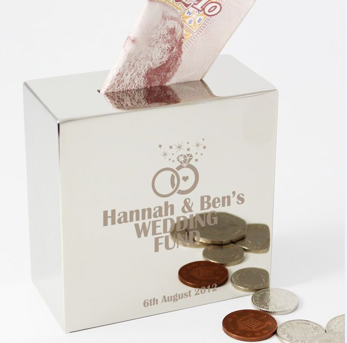 It can be difficult to buy a gift for a newly engaged couple so this personalised money box is ideal. It's also great as it'll encourgage the happy couple to save for their wedding. Personalised engagement money box is a gift the betrothed couple can enjoy forever. Personalise this silver finish moneybox with up to 3 lines of 20 characters underneath the ring design. You can also add a longer message of up to 35 characters at the bottom of the front of the moneybox. Suitable for all co...