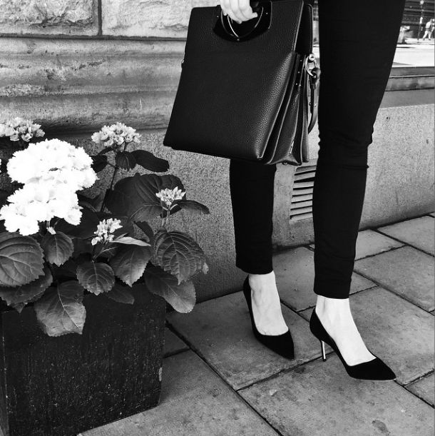 Outside our boutique in Stockholm. Manolo Blahnik BB pumps and a Christian Louboutin Passage bag. Perfect!
