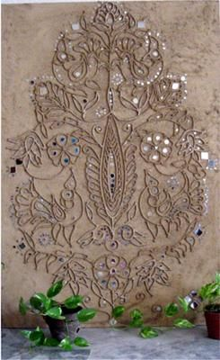 Mud-mirror work-  traditional wall murals of the Indian desert state of Rajasthan.