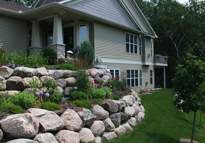 Rock Wall Garden--I like the different heights of the plants.