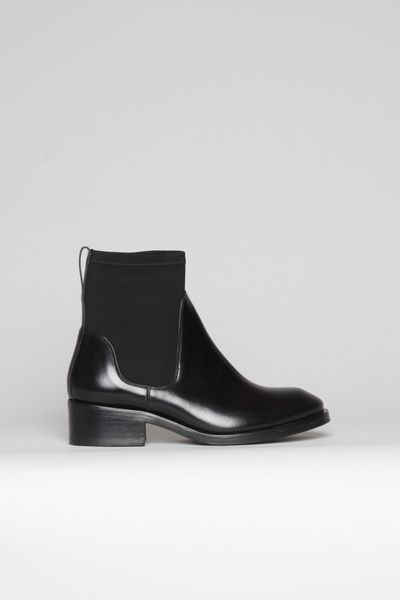 ACNE Comet Boot. Crafted from polished black leather and finished with contemporary neoprene ankle panels. #rasspshoes #contemporary #minimalist @Acne Hub Hub Studios