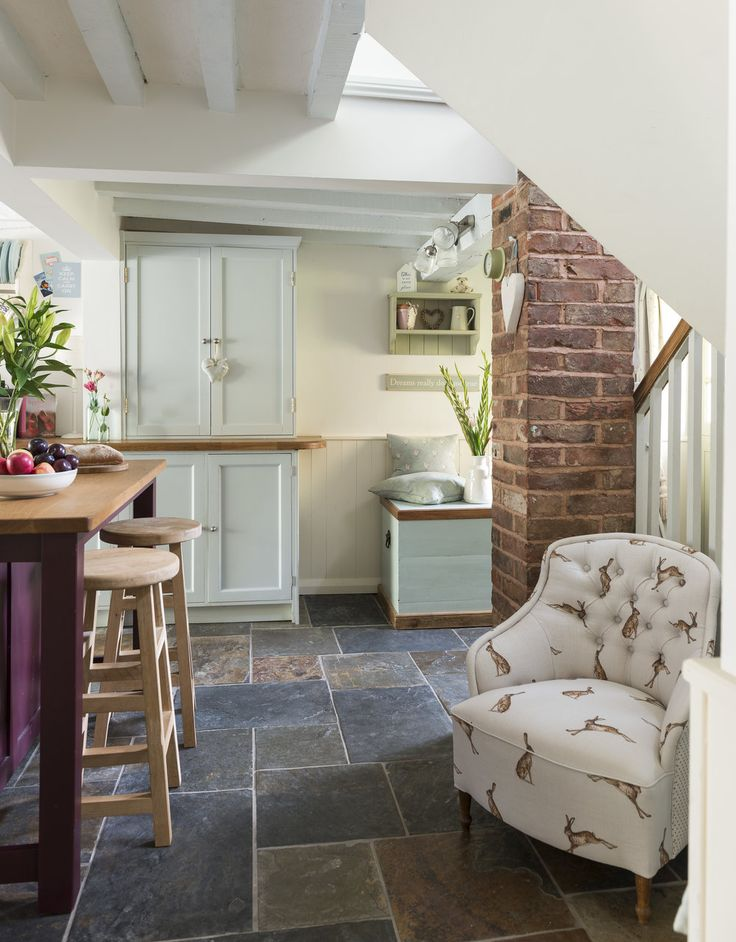 I like the idea of an armchair tucked away in the kitchen.