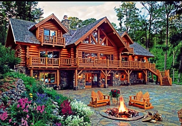 How beautiful this home is i love the fire pit in the for Alaska cabin builders