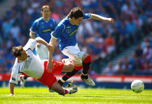 Kyle Lafferty of Rangers is tackled by Jackie McNamara of Falkirk during the Scottish FA Cup Final match between Rangers and Falkirk at Hampden Park...