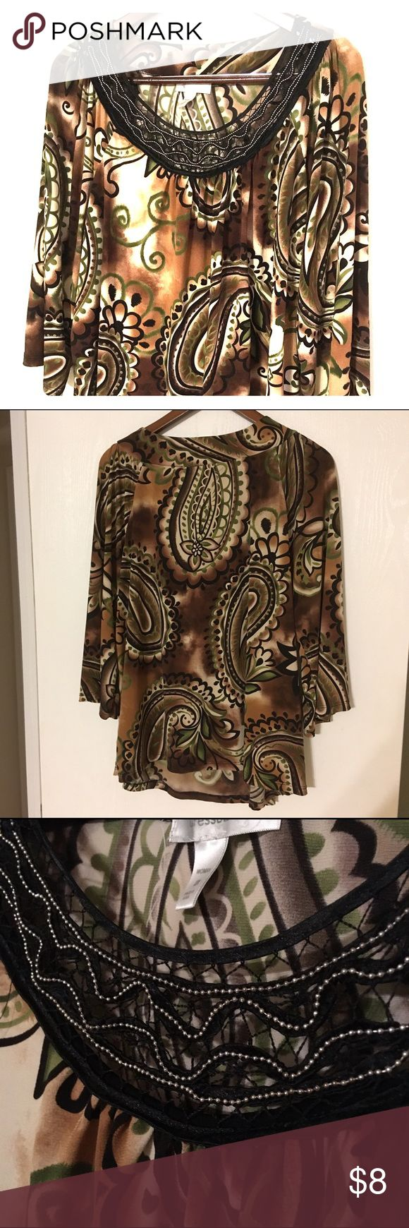 Neutral Blouse Lane Bryant brown and green blouse. Hangs and flows nicely. Well used but still in good condition. Straight hem with 3/4 sleeves. No holes rips or tears. Does not wrinkle easily. Has black and brown so it goes well with black or brown shoes/pants/accessories. Lane Bryant Tops Blouses