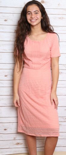 Cute, feminine textured modest dress in peach and perfect for dressing up!