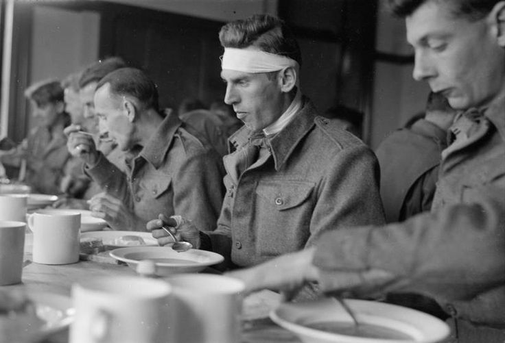 Liberated New Zealand POWs enjoying their first meal back at the Grand Hotel in Margate, Kent, England/April 1945