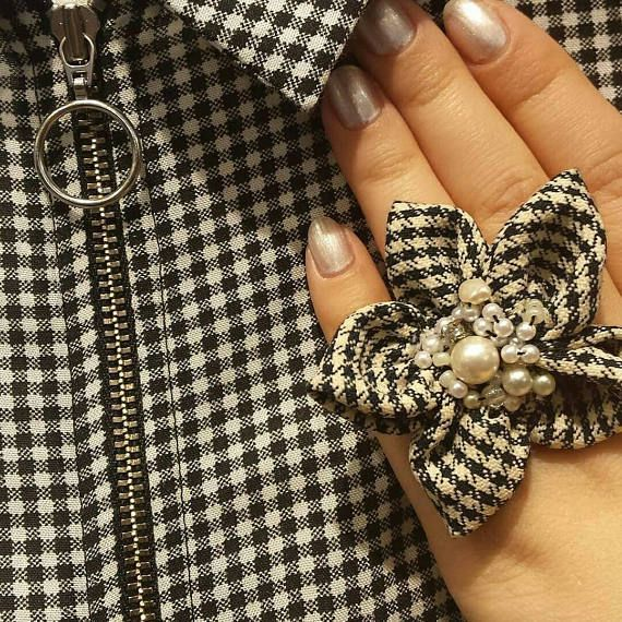 Check out this item in my Etsy shop https://www.etsy.com/listing/507978076/hound-tooth-flower-pearl-statement-ring