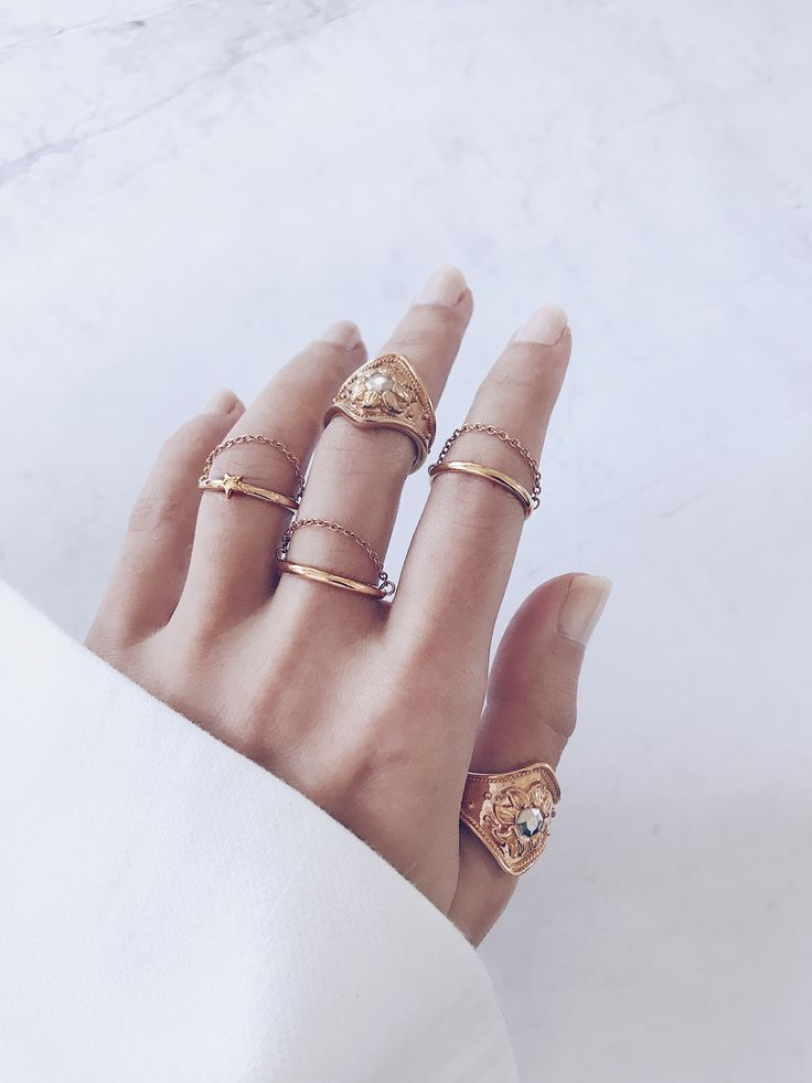 Learn how to stack your rings - Statement gold cocktail rings are perfect for creating drama and draws the eye to your fingers, while minimal chain rings add a modern touch. Create a balanced ring stack by wearing on your thumb, midi and surrounding fingers. Love these unique stacking rings? SHOP NOW BY CLICKING WEBSITE LINK